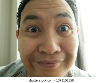 Portrait of happy funny Asian man laughing at camera, happiness joyful concept, man taking selfie photo - Shutterstock ID 1391102558