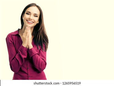 Portrait of happy gesturing smiling young woman in casual smart red clothing, over yellow.