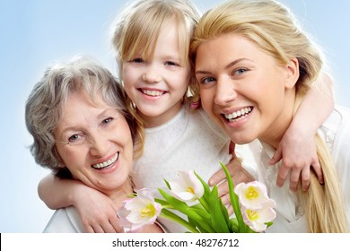 Portrait of happy girl hugging mature lady and woman
