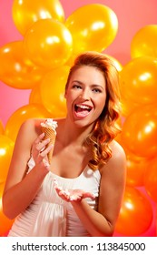 portrait of happy girl with ice cream against balloons