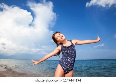 Portrait of happy girl on the beach