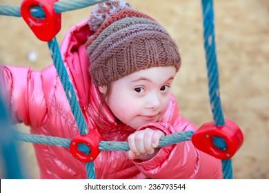 Portrait of happy girl on playground