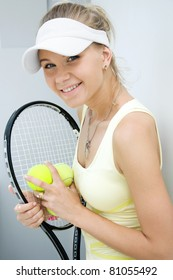 portrait of a  happy girl with a tennis racket