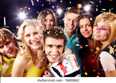 Portrait of happy glamorous friends in a night club