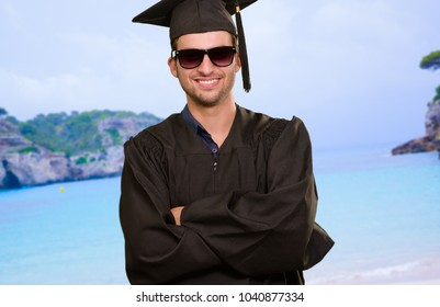 Portrait Of Happy Graduate Man, Outdoors