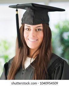Portrait Of Happy Graduate Young Woman, Indoors