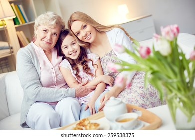 Portrait of happy grandma, mother and daughter