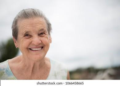 Portrait of a happy grandma - Portrait of a smiling elderly woman
