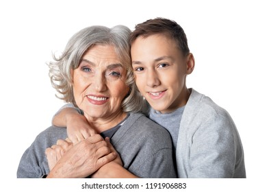 Portrait of happy grandmother and grandson hug