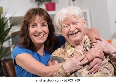 Portrait of happy grandmother with her daughter in visit