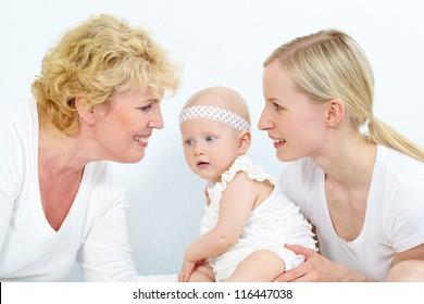 Portrait of happy grandmother, mother and cute baby girl