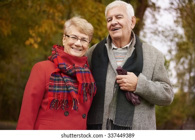 Portrait of happy grandparents in the park