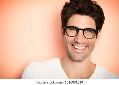 2d7e38af60 Portrait of happy guy in glasses