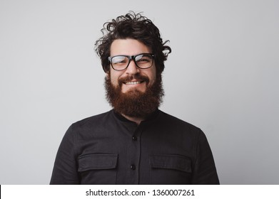 Portrait of happy and handsome bearded man looking at the camera