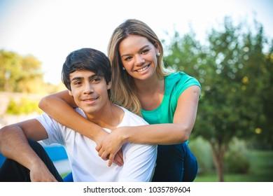 portrait of happy Hispanic couple in the park