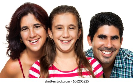 Portrait of a happy hispanic family consisting of father,mother and daughter isolated on a white background