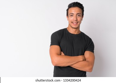 Portrait of happy Hispanic man smiling with arms crossed
