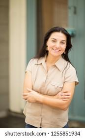 Portrait of a happy Hispanic woman