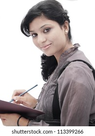Portrait of a happy Indian / Asian college student on isolated white background