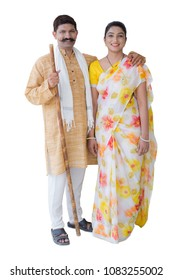 portrait of Happy  indian rural couple with stick