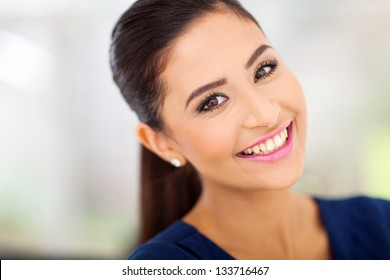 portrait of happy indian woman close up