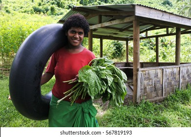 Portrait of happy Indigenous Fijian woman looking at camera and smiling in Fiji .Real people copy space