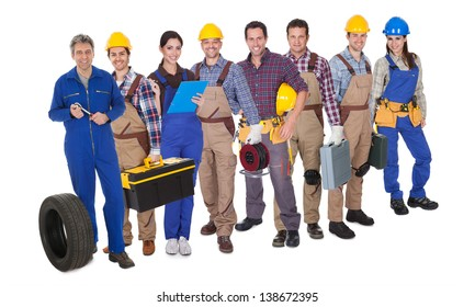 Portrait of happy industrial workers. Isolated on white
