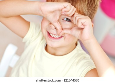 Portrait of happy joyful beautiful little boy