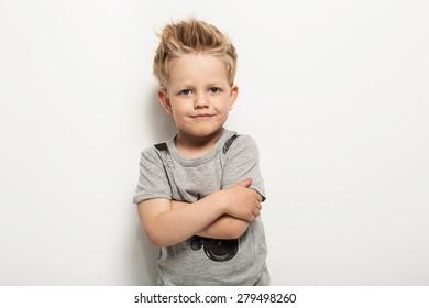 Portrait of happy joyful beautiful little boy. Studio portrait over white background