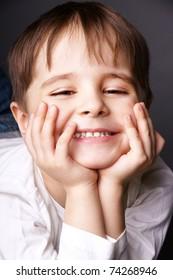 Portrait of happy joyful beautiful little boy, studio shot