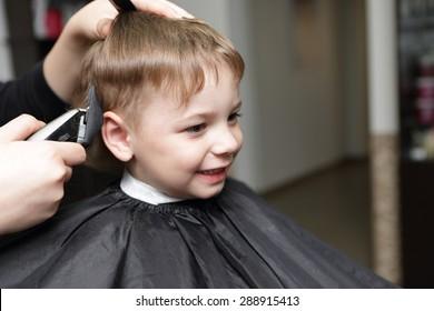 Portrait of happy kid at the barbershop