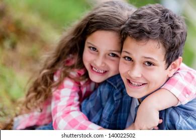 Portrait of happy kids having fun at the park