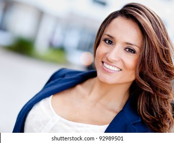 Portrait of a happy Latin woman outdoors