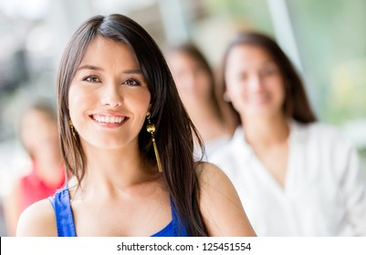 Portrait of a happy Latin woman smiling