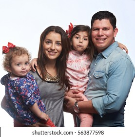 Portrait of happy latino family isolated on white background