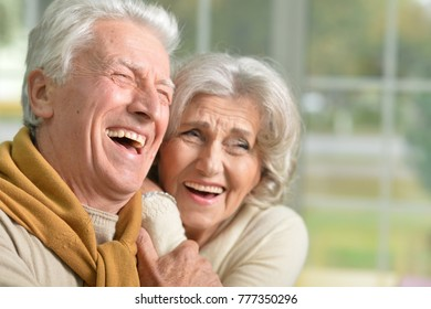 portrait of a happy laughing senior couple at home