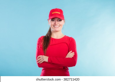b70d7e97a8c Portrait of happy lifeguard woman girl in red cap with ratownik sign on blue.  Accident