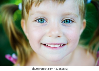 Portrait of a happy liitle girl close-up