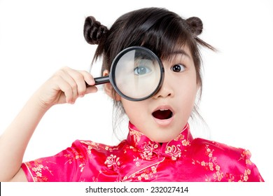 Portrait of happy little Asian child surprised with magnifying glass