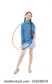 Portrait of happy little Asian child girl playing hulahoop on isolated white background