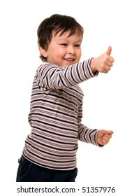 Portrait of a happy little boy showing thumbs up sign.