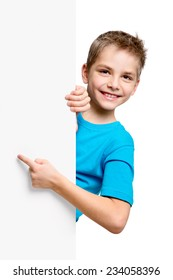 Portrait of happy little boy with white blank isolated on white background