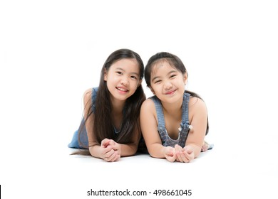 Portrait of happy little cute Asian girl smiling isolated over white background