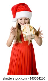 Portrait of happy little girl with gift box over white background