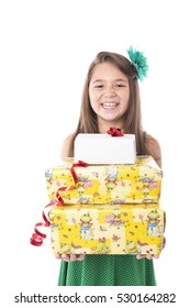 Portrait of happy little girl holding many gifts over white background