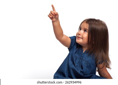 Portrait of a happy little girl on white background pointing