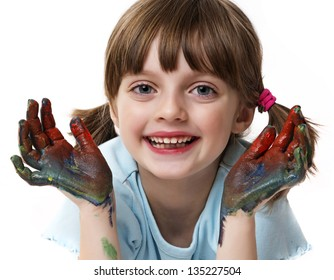 portrait of a happy little girl playing with colors