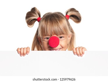 Portrait of happy little girl with red clown nose with white blank