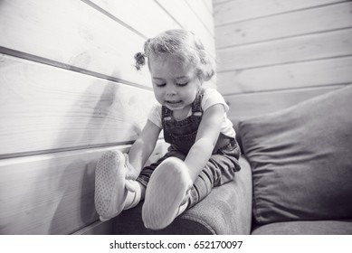 Portrait of a happy little girl sister. Child wearing pajama. Laughing and having fun playing in bed. Concept of love and happiness happy family. Black and white portrait.