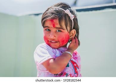 Portrait Of A Happy Litttle Girl On Happy Holi Festival Celebration Day.Festival of Colors